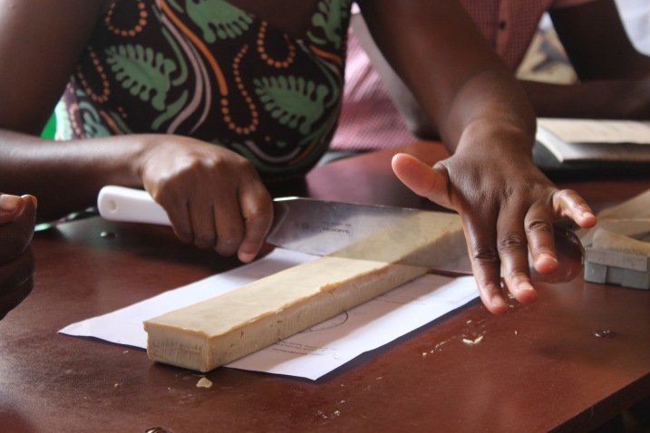 Beneficiaries cutting their first batch of soap